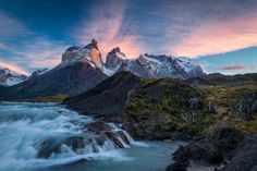 Sunrise over the Salto Grande cascades, with the Cuernos del Paine mountains - in Torres del Paine national park, Chile.  By Jim Reitz.