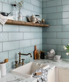 These geometric decors gives a new look with an embossed pattern & an eye catching feature costs £16.49 price/box at Topps Tiles.