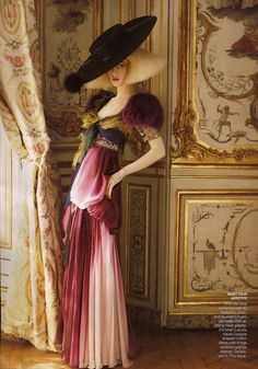 Christian Lacroix Haute Couture draped-chiffon dress with fringe neckline and fox sleeves. Photographer David Sims. Fashion Editor Grace Coddington. Model Raquel Zimmermann.