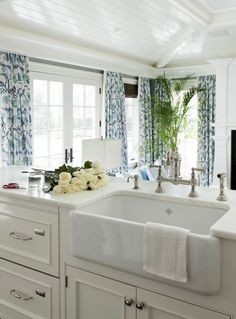 Kitchen open to a family room. It's light and airy. Love the farmhouse sink and faucet ~ Tiffany Eastman