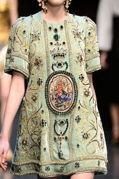 Dolce & Gabbana fall 2013 stepped down version of energy + embroidery + a bit of byzantine influence, though i dont really dig the boxy style.