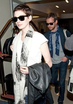 Google Image Result for http://fashiontrendseeker.com/wp-content/uploads/2012/05/Anne-Hathaway-With-Pixie-Haircut-2.jpg