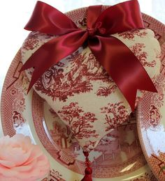 A friend gave me a red and white toile heart just like this for Valentine's Day one year.  It was a lovely gift.