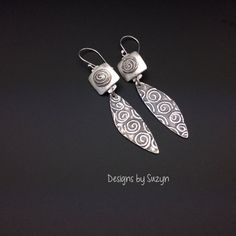 """These really special earrings are little works of art...and have been completely hand made by me.     These earrings have been meticulously created by me, by hand.  Each pair is one of a kind with hand drawn designs.      The silver is enhanced sterling silver, which is a blend of fine silver and sterling silver, making the silver content .960,  These earrings hang 3"""" from the top of my hand made Argentium  silver ear wires.  These are 1/2 """"in diameter at the widest point.   Substantial…"""