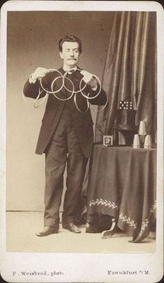 ca. 1870s, [carte de visite, portrait of a magician with linking ring, other props and tricks, including a black top hat],  F. Weisbrod