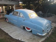 Baby blue 49 Chevy Sport Coupe on custom lowered suspension, 3/4 rear view