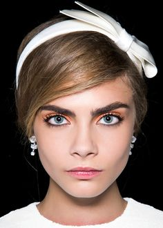 Hair accessories: Louis Vuitton spring/summer 2013 runway Straight from the runways in the City of Light: Bow headbands are the latest incarnation of Parisian chic. Immaculate white, black velvet or satiny chocolate, we adore these girly and totally trendy accessories.