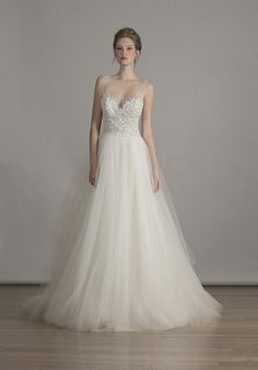 Hand-beaded embroidered bodice w/illusion neckline & back on tulle ball gown.