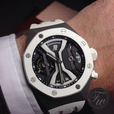 """""""@AudemarsPiguet Royal Oak #Concept GMT Tourbillon on @fratellowatches' wrist!  """"To break the rules, you must first master them"""". #LoveWatches"""""""