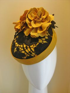 Dijon. Mustard leather button hat, covered in black guipure lace and two tone mustard leather flowers