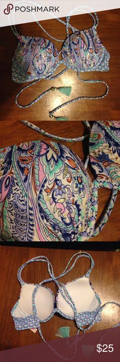 VS Bikini Top It's a size 32B but can also fit 34B. Never has been worn (bought from another user & took tag off), but it is brand new. Has a beautiful pattern and it is a push bra. PRICE IS FIRM but am open to reasonable trades :) Victoria's Secret Swim Bikinis