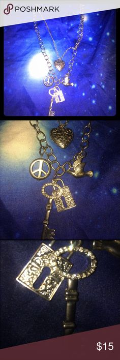 Chunky Charm Layered Necklace Bling Layered Heart Lock Key Bird Peace Necklace. From Torrid, using Claire's for exposure ❤️ 🔐 ✌🏻 🐦 Claire's Jewelry Necklaces