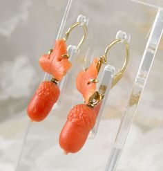 Victorian coral acorn earrings --    The Victorians had a deep appreciation of nature.   Naturalist motifs were incorporated in to the Jewelry and Decorative arts of the era.    Symbolism was also important to the Victorians.    Here we have dual symbolism;  natural coral has been delicately carved into leaves and acorns.   Acorns from mighty oak trees were a symbol of strength,  endurance and long life.   Coral was worn as an amulet to protect the wearer from harm