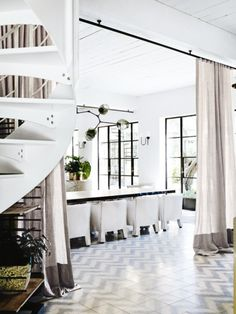 "Renovation: Justin Hemmes transforms his family's historic waterfront mansion: ""Our friends used to love coming over because there was always an uplifting atmosphere with great food, excitement and fun.""   A spiral staircase, custom-designed by Hess Hoen, was installed to increase the flow between floors."