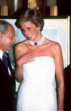 The Princess of Wales with President Gonz at a dinner in Budapest, May 1990. She wears a strapless gown by Catherine Walker, and a pearl choker with a sapphire clasp. (Photo by Jayne Fincher/Princess Diana Archive/Getty Images)