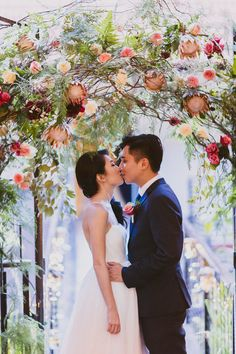 Wedding wildflower floral arch // Yongfeng and Reina's Beer Garden-Themed Wedding at Nosh