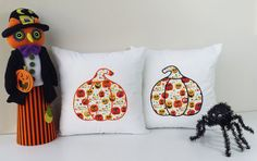 Adorable Halloween pumpkins! Get into the spirit and bring your Halloween decorations together with these pumpkin throw pillows. Pillow covers make decorating fun and easy! #roomcraft