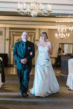 A bride is walked down the aisle by her father at Brierwood Country Club in Buffalo, NY