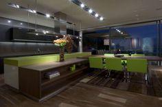 el comedor y la cocina en un solo ambiente ...fusion con sobriedad