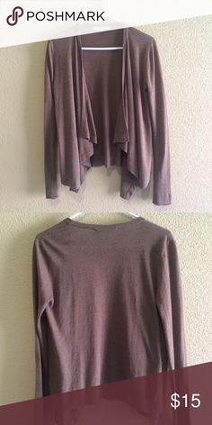 LOFT brown cardigan Description: Soft brown long sleeve cardigan with slight ruffle detail. Size: Small Brand: LOFT by Ann Taylor Condition: Good condition. Slight pilling throughout cardigan. 55% rayon, 25% polyester, 20% cotton LOFT Sweaters Cardigans