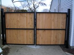 Wood & Steel Motorized Gate by Lighthouse Door Company.  For more info:  http://montereyconstructionguild.us/
