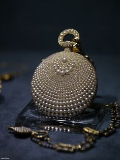 wasbella102:    A pearl encrusted pocket watch