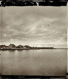 "St. Augustine, Florida, circa 1865. ""View of town from bay."" Wet-plate glass negative, left half of stereo pair, by Samuel A. Cooley."