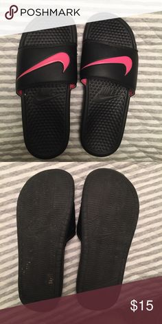 Women's Nike Slides Women's hot pink and black Nike slides, size 7. Only worn a few times and in great condition. Nike Shoes Sandals