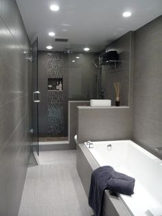 Great layout for long, narrow bathroom. Modern, clean lines | jdl homes Vancouver | vancouver-pied-a-terre #smallbathroomrenovations