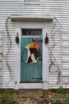 Primitive Spring Welcome...rabbit with a flag door decor.