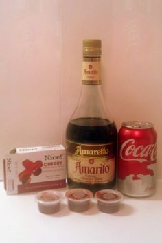 Cherry Cola jello shots--1 small box cherry jello, 1 cup boiling water, 1/2 cup coke, 1/2 cup amaretto (makes approximately 30 .75 oz cups)