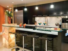 Attractive Kitchen Decor Ideas To Modern Pendant Ceiling Lights Above Marble Island With Black Cabinets