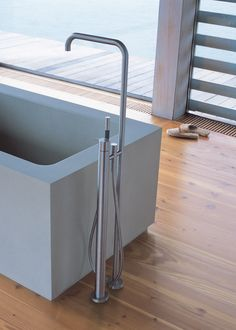 Vola offers a floor-mounted thermostatic tub filler with spout as well as floor-mounted spouts, available in four different heights, for custom applications.