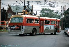 TTC  FLYER TROLLEY COACH PULLING OUT OF THE DEPOT.
