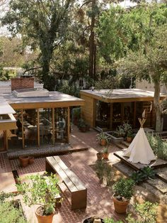 a courtyard that acts as an outdoor living room   source