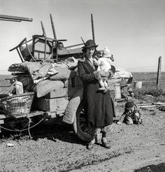 "February 1937. ""Missouri family of five, seven months from the drought area. 'Broke, baby sick, car trouble.' U.S. 99 near Tracy, California."""