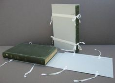 Protective method for damaged books being trialled. For libraries and archives where there isn't room to store damaged books flat.