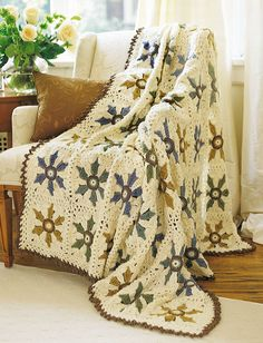 Elegant Floral blanket that is definitely worth making! I think it's beautiful!!... FREE PATTERN!