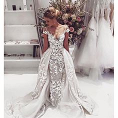 I don't even know if I would actually wear this but I'm solely pinning for being one of the most gorgeous wedding dresses I've ever seen!