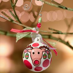 Ceramic ball ornament with bead and bow accents and a festive motif.  Product: OrnamentConstruction Material: Ce...