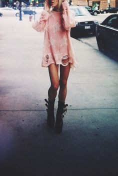 big pink slouchy ripped sweater with combat boots