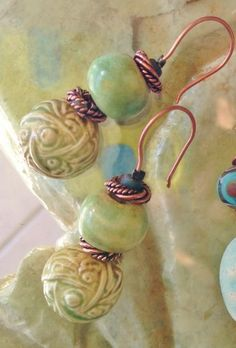 Handmade porcelain and copper  by Sheri Mallery of SlinginMud.etsy.com