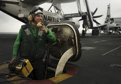 PACIFIC OCEAN (May 9, 2013) Aviation Boatswain's Mate (Equipment) Airman Robert Rahn, from Muskegon, Mich., relays instruction to raise and lower a jet blast deflector on the flight deck of the aircraft carrier USS Nimitz (CVN 68). Nimitz is underway on a scheduled western Pacific deployment. (U.S. Navy photo by Mass Communication Specialist Seaman Kole E. Carpenter/Released).