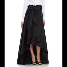 Adrianna Papell Hi-Low Taffeta Skirt For an updated special-occasion look, a classic taffeta skirt flashes some leg with a rippling high/low hem. A wide sash at the waist adds lush drama and accentuates the flattering A-line silhouette.  From Adrianna Papell, this women's skirt features: taffeta self tie at waist hi-low hem polyester Adrianna Papell Skirts