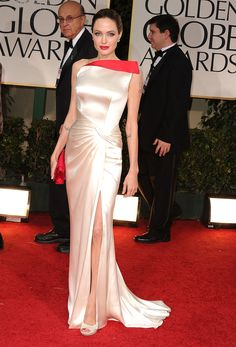 The star went for serious Hollywood glam in a bold one-shouldered cream Versace dress with a dramatic red collar accent. We love how she accented the look with a perfectly matching clutch and red lip.
