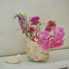 Beautiful ceramics and flower arrangement by Cécile Daladier