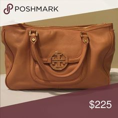 Tory burch leather hobo bag Pieced-leather construction elevates a structured hobo trimmed with a cutout logo medallion on the front pocket flap. An optional shoulder strap increases the versatility of the chic piece. Magnetic closure. Exterior slip pocket. Interior zip, wall and cell-phone pockets. Protective metal feet. Leather. By Tory Burch; imported. Tory Burch Bags Crossbody Bags