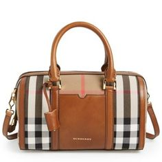 Burberry 'Medium Alchester' Crossbody Satchel Burberry 'Medium Alchester' Crossbody Satchel Inspired by heritage travel carryalls, this structured bowling bag nods to Burberry's vintage designs with its polished luggage lock and leather key holder. Iconic house checks make a bold signature statement, while hand-painted edges and hand-stitched rolled handles showcase the brand's impeccable craftsmanship. Interior zip, wall and smartphone pockets. Textile with leather trim. Protective metal…