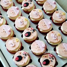 Baby shower face cupcakes