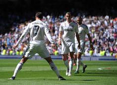 Cristiano Ronaldo of Real Madrid CF celebrates after scoring his team's 4th goal during the La Liga match between Real Madrid CF and Granada CF at Estadio Santiago Bernabeu on April 5, 2015 in Madrid, Spain.